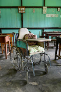 Moses' wheelchair, funded by Liliane Fonds, stays at school. This is the most practical solution. At home Moses practices with his foot splints.